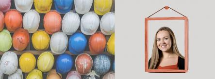 Construction site management apprentice and colourful hard hats