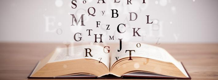 Letters of the alphabet emerging from a book - careers as an author