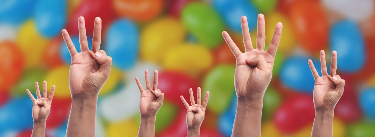 hands showing either three or four fingers, representing choices about how many A levels to take