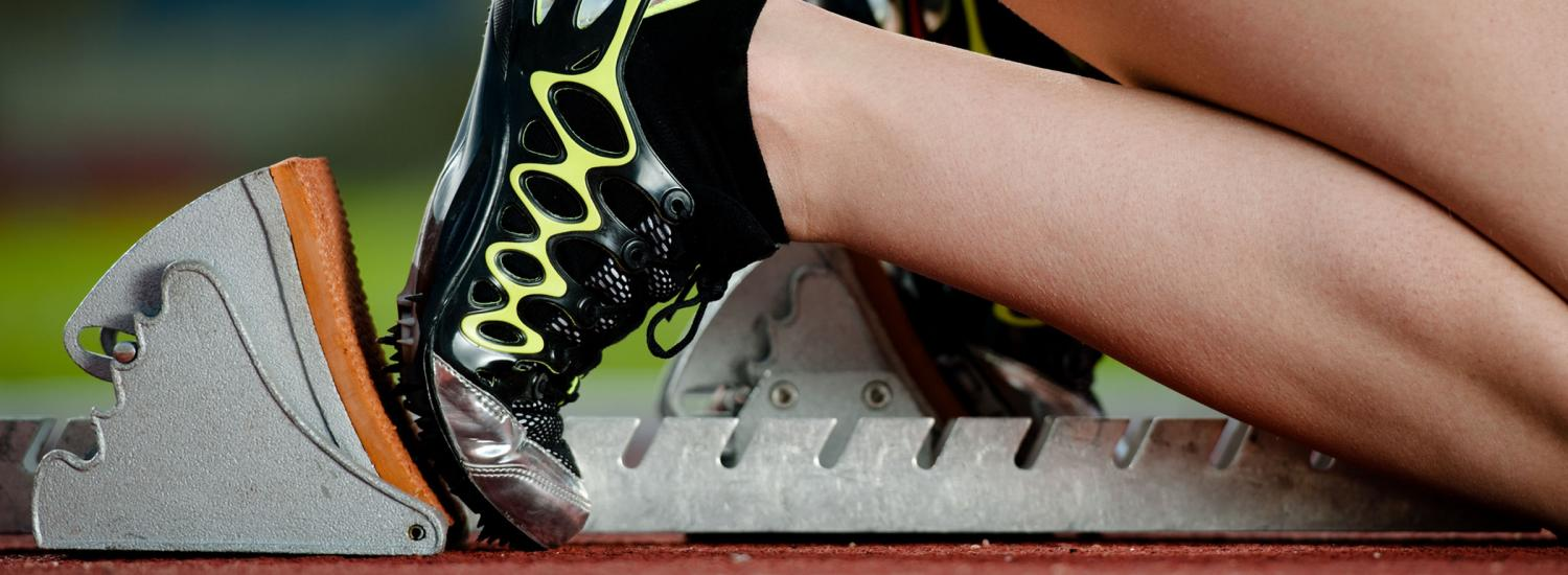 Close up of female athletes starting block position