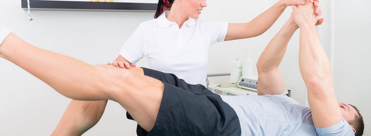 A physiotherapist working with a client