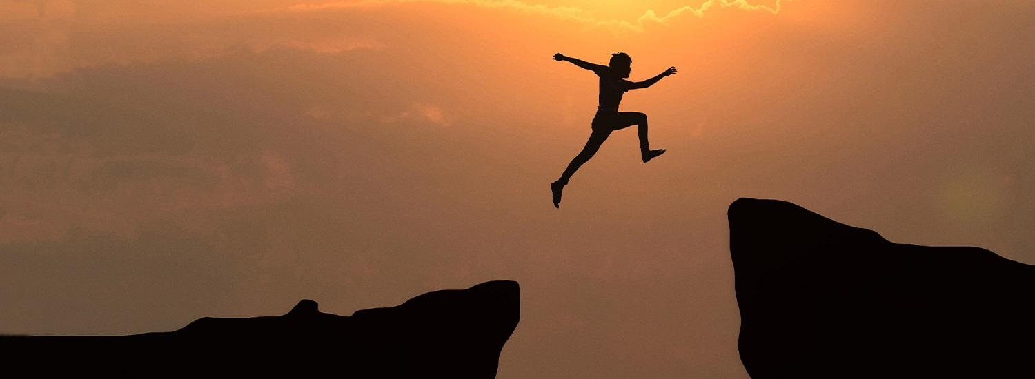 Person leaping between cliffs - how difficult is an apprenticeship?