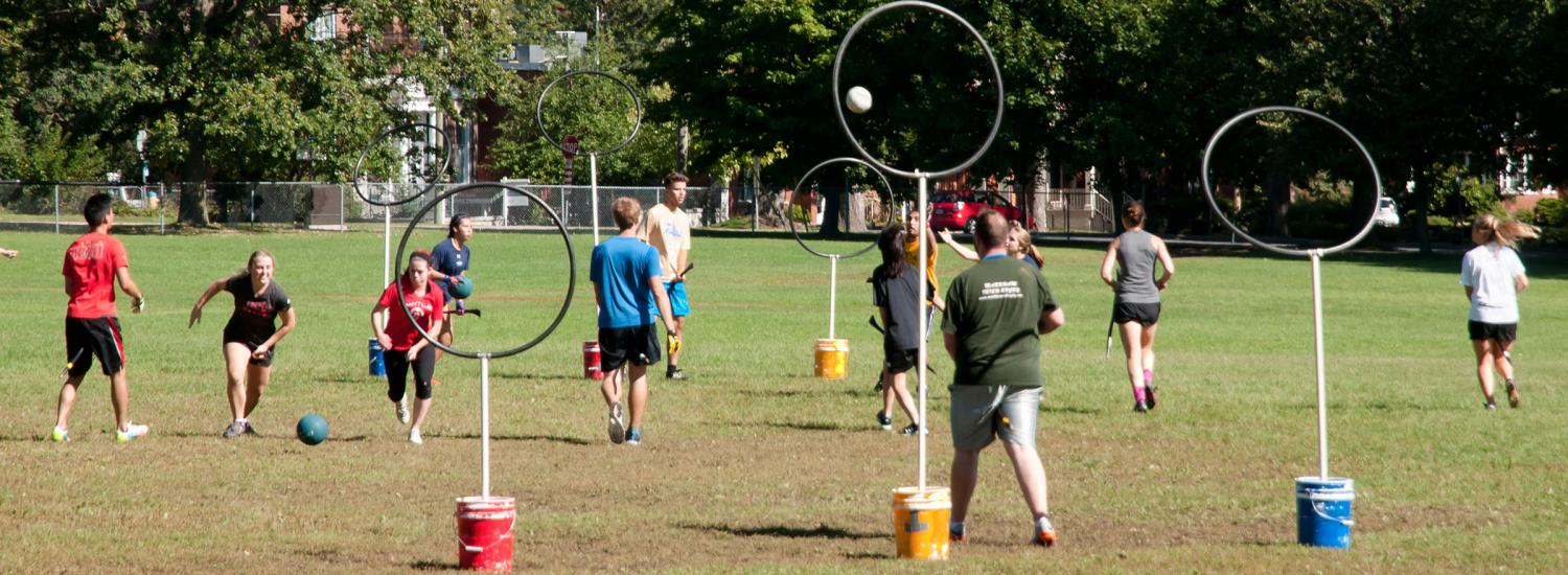 Group of people playing Quidditch