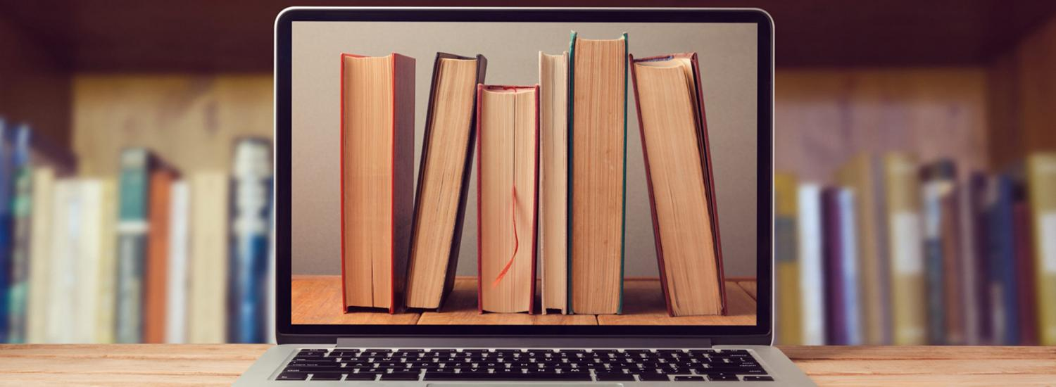 Image of books on laptop screen, representing revision resources