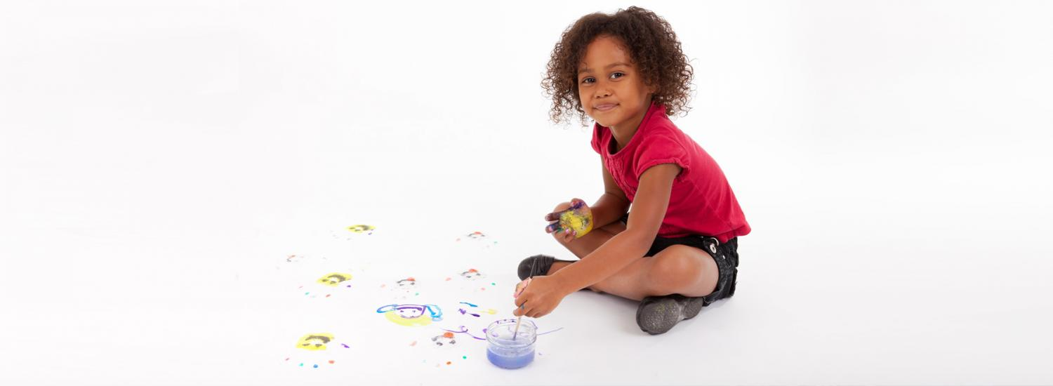A child painting - careers working with children