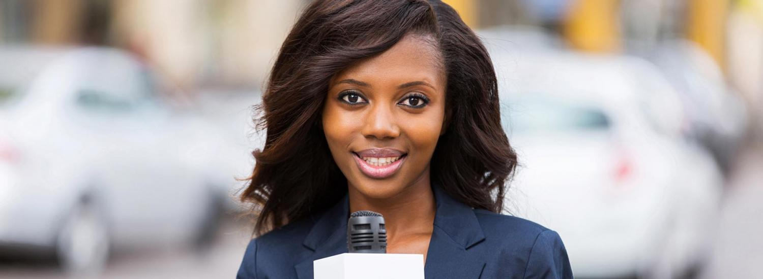 Young woman working in a media job